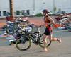 Dan Graham demonstrating pushing his bike from the saddle
