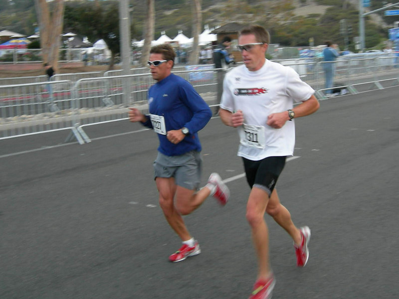 Coaches Mike & Carl go through the halfway mark of the 10k in 18:00.