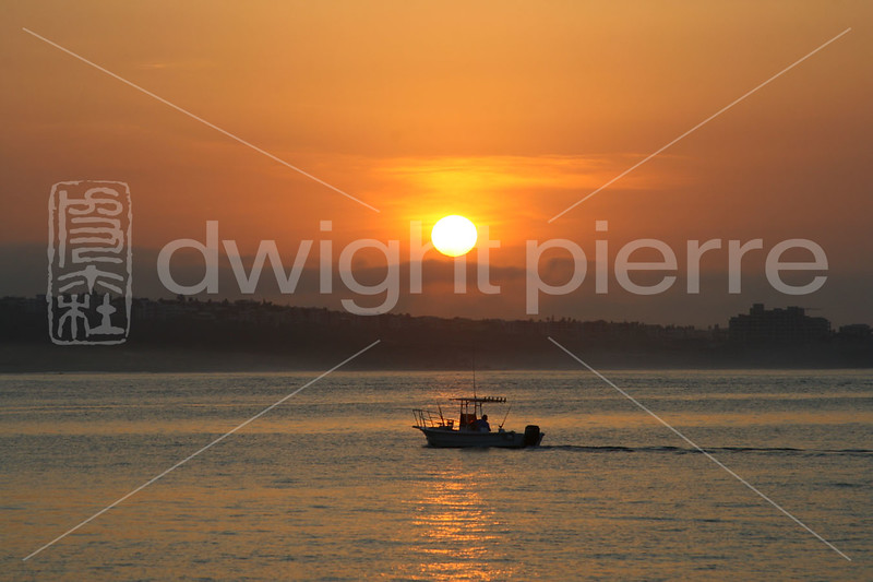 Sunrise with small boat Cabo web