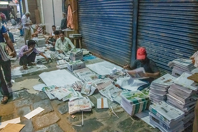Early morning newspaper distribution site.