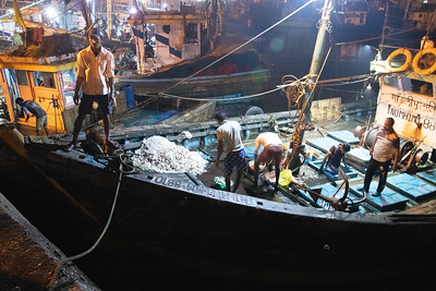 Koli fisher-folk risk the Arabian Sea at night.