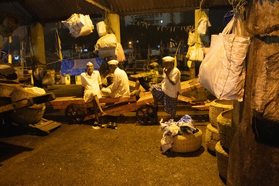 Dabbawallas wait for the distribution to be complete.