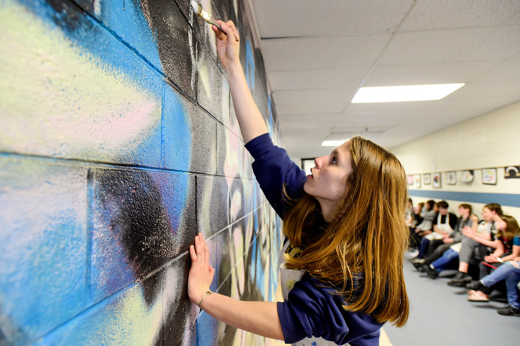 . BROOMFIELD, CO - APRIL 8:Eighth grader Sabrina Rachjaibun paints a section of the mural at Westlake Middle School in Broomfield on April 8, 2019. Artist Michael Gadlin is working with students to paint a 34-foot-long mural inside the school. (Photo by Matthew Jonas/Staff Photographer)