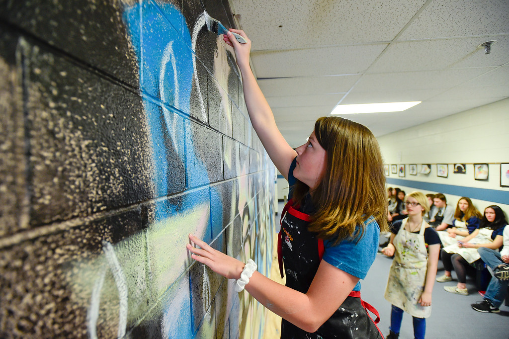 . BROOMFIELD, CO - APRIL 8:Eighth grader Alison Seybold works on a mural with other students at Westlake Middle School in Broomfield on April 8, 2019. Artist Michael Gadlin is working with students to paint a 34-foot-long mural inside the school. (Photo by Matthew Jonas/Staff Photographer)