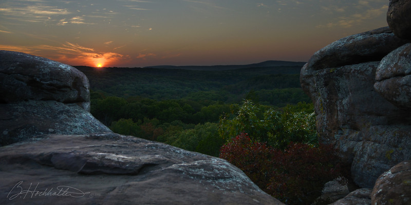 SUNSET AT GARDEN OF THE GODS - Shawnee National Forest, Illinois<br /> <br /> Shawnee National Forest encompasses over 280,000 acres across nine different counties in Southern Illinois. Garden of the Gods, located in Saline County, affords spectacular view of the surrounding countryside, and boasts one of the best vantage points for catching a beautiful sunset.<br /> <br /> The sandstone rock formations at Garden of the Gods are about 320 million years old. At one time, most of Illinois, western Indiana and western Kentucky were covered by a giant inland sea. As rivers carried sand and mud to the sea, layers of sediment formed which compressed over time into rock thousands of feet thick. At Garden of the Gods, they were about 4 miles deep. <br /> <br /> Shifts in the Earth's surface filled in the inland sea and fractured the bedrock, exposing it to wind, rain and freeze/thaw cycle.  Over time, these natural forces sculpted from the layers of sediment the beautiful formations known as Garden of the Gods.<br /> <br /> There are many miles of hiking and backpacking trails in the Shawnee National Forest. Trails range in difficulty and length, from the quarter-mile stone paved Observation Trail at Garden of the Gods, to the more rugged 160-mile River to River Trail.