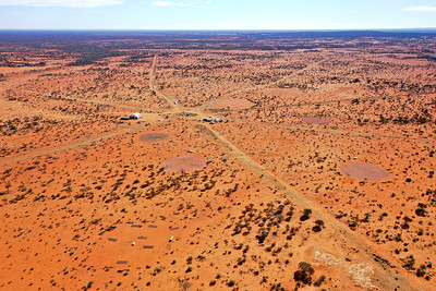 An aerial shot of part of CSIRO's Murchison Radio-astronomy Observatory (MRO). Near the centre of screen, the AAVS1.0 and AAVS1.5 (incomplete) stations are visible. To the right, the Engineering Development Array stations.