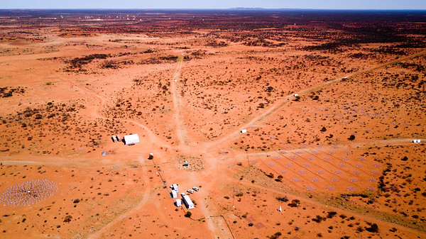An aerial shot of part of CSIRO's Murchison Radio-astronomy Observatory (MRO). In the lower left corner is AAVS1.0. Lower right is the South Hex of the Murchison Widefiled Array (MWA), near to the core of the telescope. At the top of screen, the dish antennas belonging to the Australian SKA Pathfinder(ASKAP) are just visible.