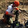 Tree climber John Heilferty prepares his equipment.