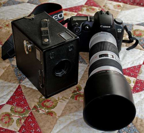 Old box camera and Canon D30