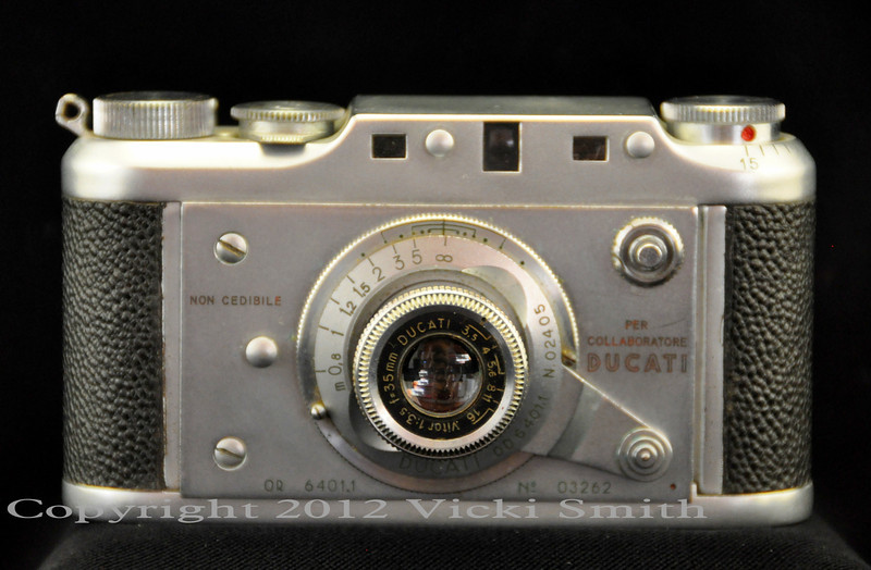 Societa Scientifica Radio Breveti Ducati was founded in 1926 in Bologna, Italy.  One of the items they eventually produced in the mid 1940's was this highly prized camera. This is a half frame 35mm microcamera, similar in look and feel to the full frame Leica that it is often compared to but without a doubt, this was by far the finer camera in it's day.  One review I found on line said it was the difference between a VW Jetta and a Ferrari, and for this reason are very desirable to collectors of fine cameras, not just Ducatista.
