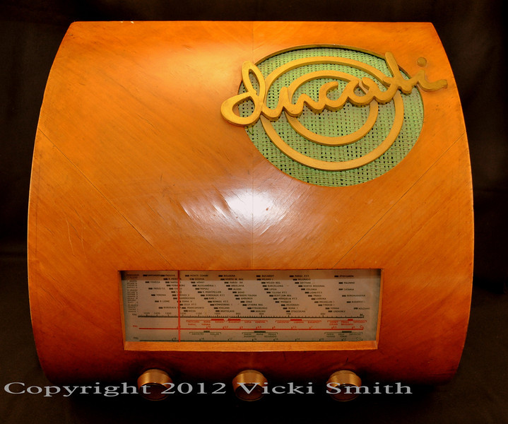 Ducati Radio model RR3404.5. The most famous one Ducati built because of it's size and fancy shape.  All details on this radio are in wood which is in remarkably nice condition given it's age.  It is also in working condition but like all Ducati electronics, prefers Italian voltage