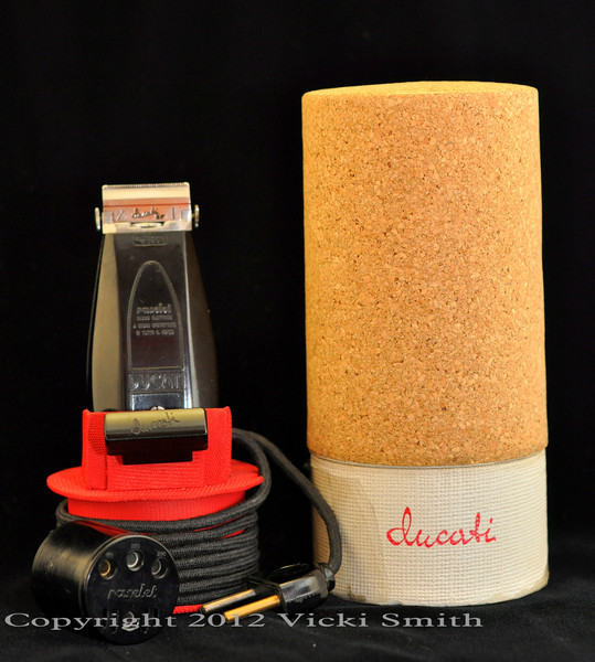 This mint condition Ducati shaver (Raselet in Italian) was delivered to us in Firenze, Italy new, still in the celephane wrapper, making it one of the best examples known to still exist. Introduced in 1940, the Ducati Raselet was the first electric shaver produced in Italy and one of the first produced in the world as well. It is extremely high quality, the details are remarkable, even the box, which is cork, is unusual and of high design