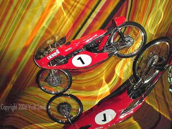 """What made this show special was the attention to detail of the installation.  This Debi 50cc GP racer was suspended on a huge waterfall of cascading sheetmetal. It;'s impossible to catch the scale of it - in 2001 I was just learning to use a camera (this is one of my first """"galleries"""") and my camera was just a small digital."""