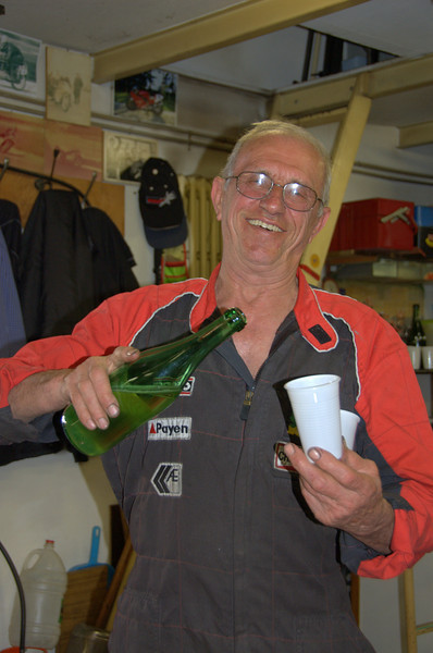 Always wine for visitors. Served with a smile. This is not a posed photo, that's a typical, Rino serving the wine moment