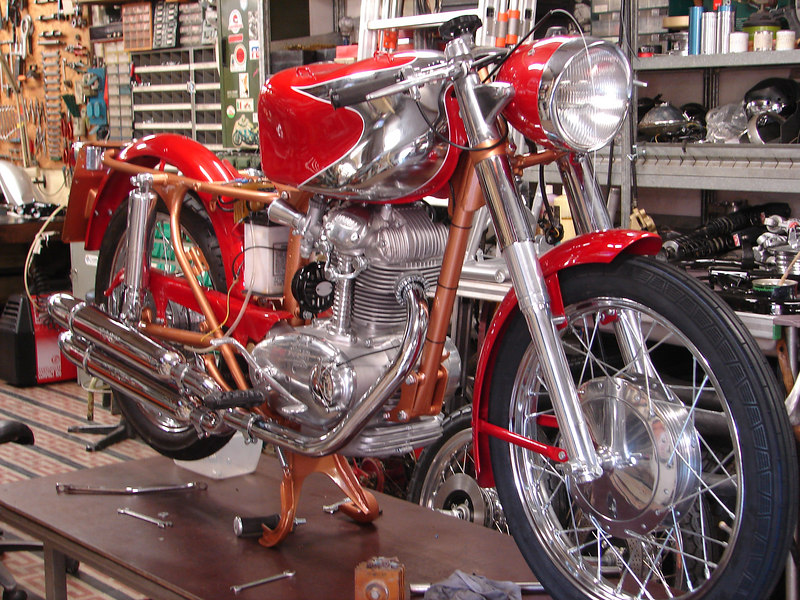 """Rino Caracchi's (the """"C"""" in NCR) workshop is a marvel of Ducati treasures.  This is a 200 Elite being built for a customer."""