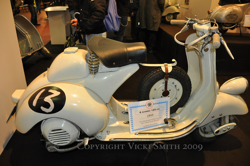 I have one like this at home, with 2 seats.  Now I want to make it into a racer, lol.  Now all I need is another crazy old Vespa owner to race...