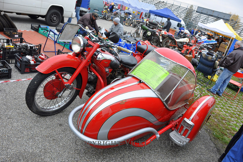 Moto Guzzis are everywhere but this one stood out with it's flamboyant sidecar