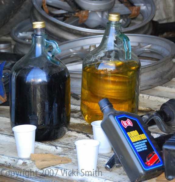 Essentials of the swap meet, oil and vino. Quantity's required speak for themselves