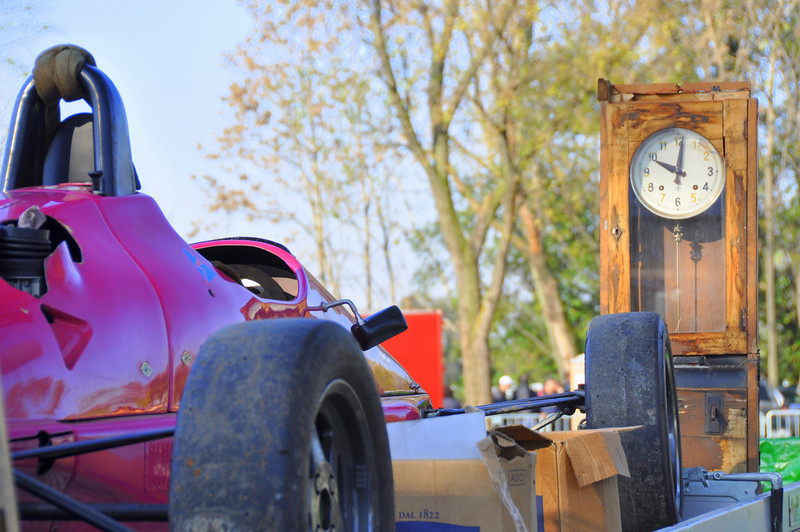 A Pink open wheel race car and antique grandfather clock,  another natural combination here at Novegro