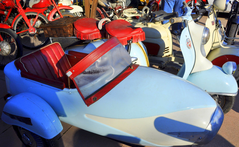 This scooter and sidecar rig would snap heads in Florida but here it's just another machine for sale