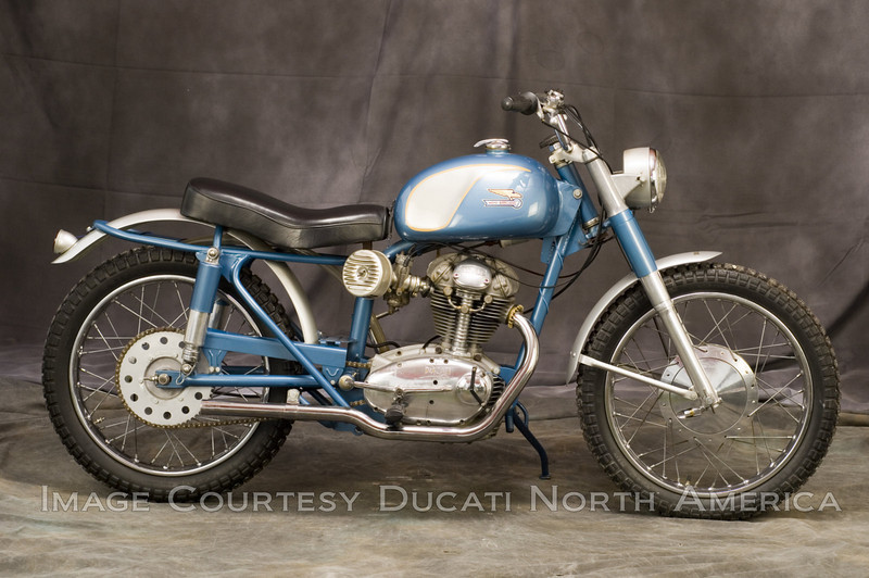 1963 250 Scrambler <br /> OWNER - Steve Brown<br /> Condition - Restored<br /> Designed as a 4 in one model that could be used as road racer, flat tracker, enduro or street bike, the 250 Scrambler was Ducati's first serious attempt at a production multi purpose machine.