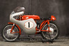 "1957 125 Gran Sport ""Marianna""<br /> OWNER - Jerry Dean<br /> Condition - Restored<br /> Built in several displacements and very limited numbers, this is the 125 cc version of the highly successful factory production racer."