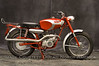 "1964 Mountaineer<br /> OWNER - Elliott Van Steele<br /> Condition - Restored<br /> Early hand shift, fan cooled 2 stroke, ""dual purpose"" machine."