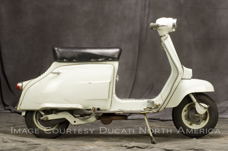1967 Brio Scooter<br /> OWNER - Michael Mineer<br /> Condition - Original Unrestored Ridden Daily<br /> Offered in three sizes, 50, 100 and 125 cc, the Brio was a true scooter in the Vespa and Lambretta mold. Small numbers of 100 and 125's were offered to the US market.