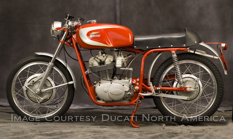 1965 250 SC<br /> OWNER - Jerry Dean<br /> Condition - Restored<br /> Extremely rare factory hand built racing machine, featured sand cast engine cases with special cylinder head, 5 speed close ratio transmission and double downtube frame.