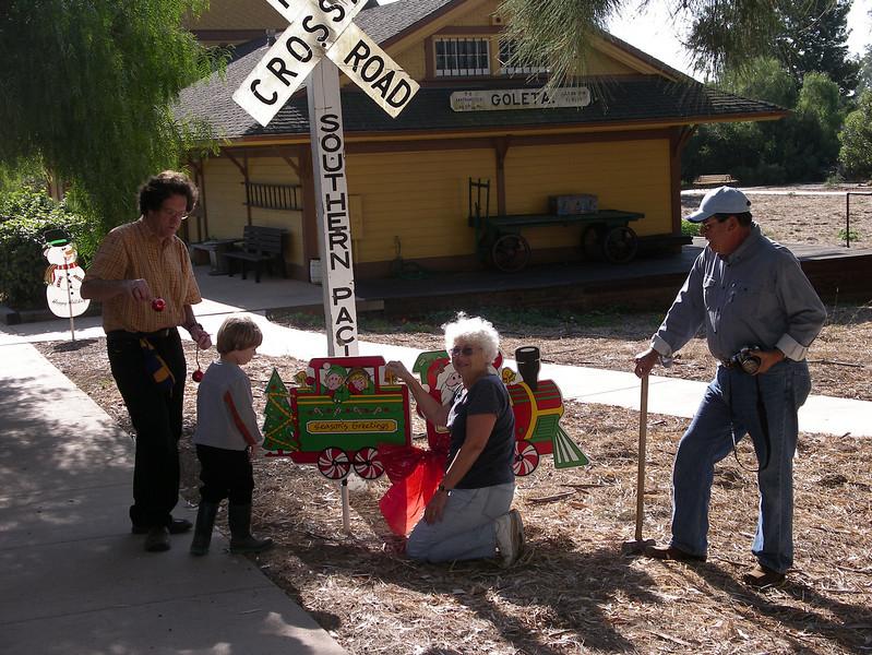 Volunteers Seth and Ian Olitzky, Carla Cabanatuan, and Marc Bradley, 2006.