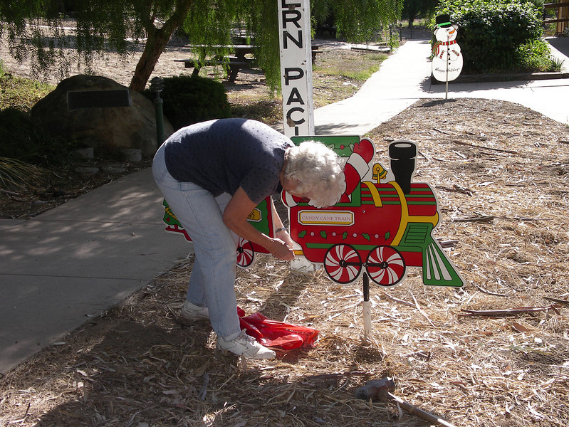 Carla Cabanatuan installs one of the grounds decorations in 2006.
