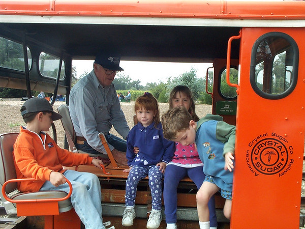Rides on Bob Mahan speeder is a favorite Depot Day activity.