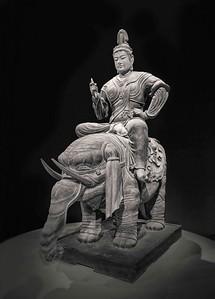 Hindu God Indra riding on an elephant.