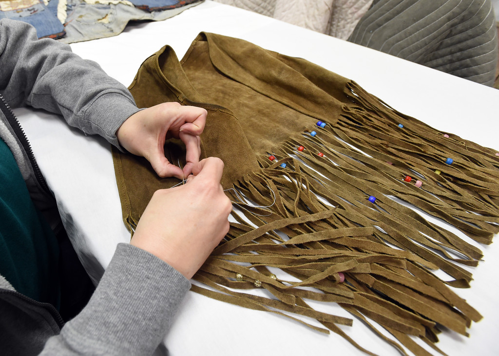 ". KristenLewis prepares to label a ""hippie vest\"" to be put on display. The new Museum of Boulder, opening next year, has announced its permanent exhibits and the crew over at its Gunbarrel artifacts facility were cataloguing and preparing the artifacts for the exhibits. Cliff Grassmick  Staff Photographer April 5, 2017"