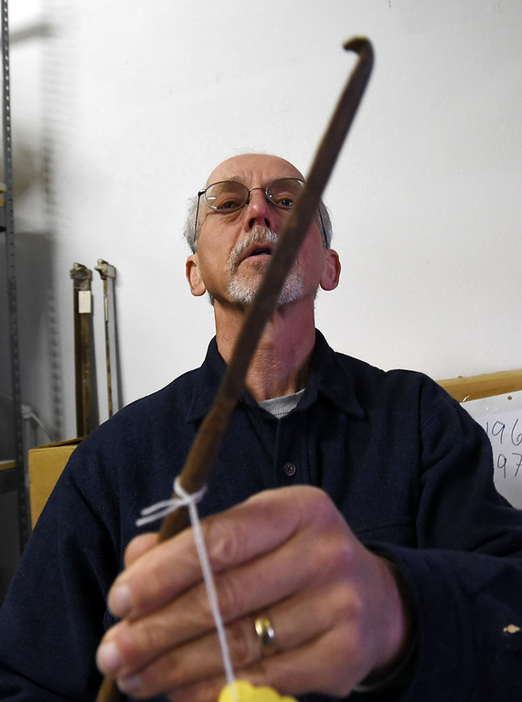 . Tim Imbrock holds an old mining tool used to clean out drill holes. The new Museum of Boulder, opening next year, has announced its permanent exhibits and the crew over at its Gunbarrel artifacts facility were cataloguing and preparing the artifacts for the exhibits. Cliff Grassmick  Staff Photographer April 5, 2017