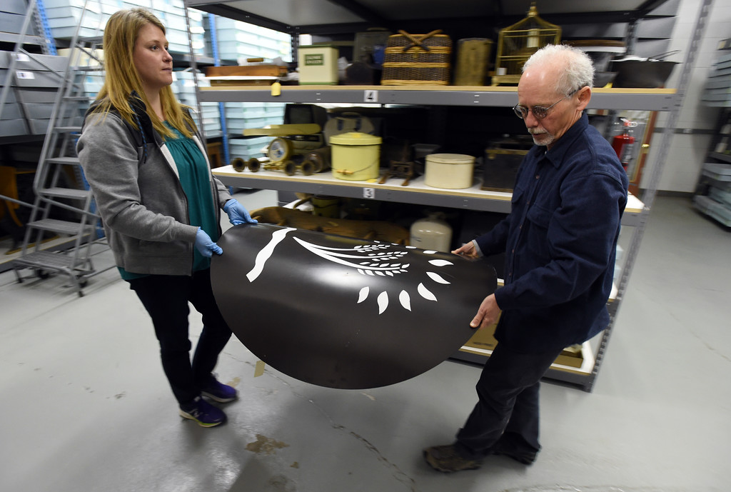 . Kristin Lewis and Tim Imbrock, move an old Wild Oats sign to a new location. The new Museum of Boulder, opening next year, has announced its permanent exhibits and the crew over at its Gunbarrel artifacts facility were cataloguing and preparing the artifacts for the exhibits. Cliff Grassmick  Staff Photographer April 5, 2017