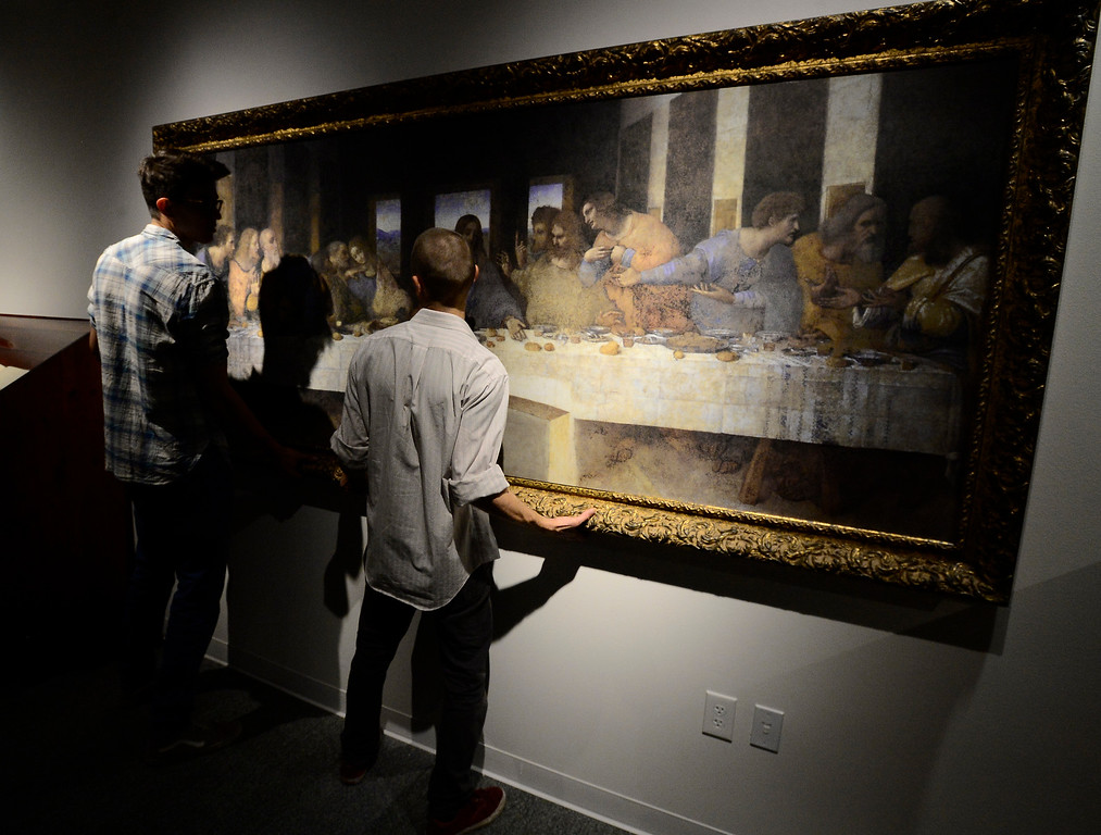 . From left to right Peter Chopra and Russell Daily hang a reproduction of Leonardo da Vinci\'s The Last Supper as part of the da Vinci\'s Machines exhibit at The Museum of Boulder� on Tuesday. For more photos go to dailycamera.com Paul Aiken Staff Photographer May 4, 2018