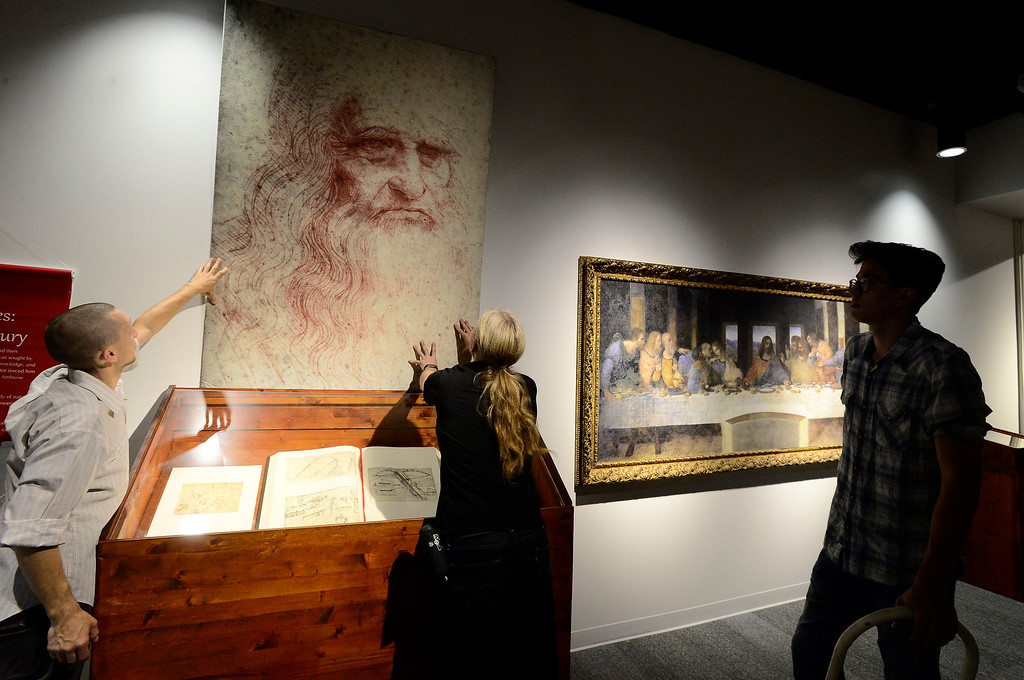 . From left to right Russell Daily Tom Rizzo and Peter Chopra hang a reproduction of Leonardo da Vinci\'s self-Portrait of a Man in Red Chalk next to The Last Supper as part of the da Vinci\'s Machines exhibit at The Museum of Boulder� on Tuesday. For more photos go to dailycamera.com Paul Aiken Staff Photographer May 4, 2018