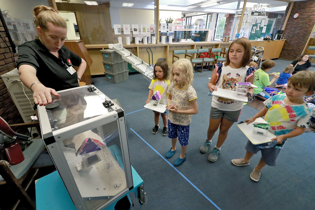 . The Museum of Science Presented, Blizzards: Outwit the Elements! at the Fitchburg Public Library on Thursday afternoon, August 2, 2018. The kids were taught to go through the engineering design process to build structures that can withstand the forces of natural disasters. They had a blizzard machine to test the kids ability to build a roof to keep snow out of a structure and off the roof. Adinah Greene with the Museum of Science helps kids test their roofs in the blizzard machine. SENTINEL& ENTERPRISE/JOHN LOVE