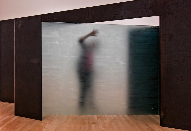 A frosted acrylic panel, behind which one could walk and create ghostly shadows.