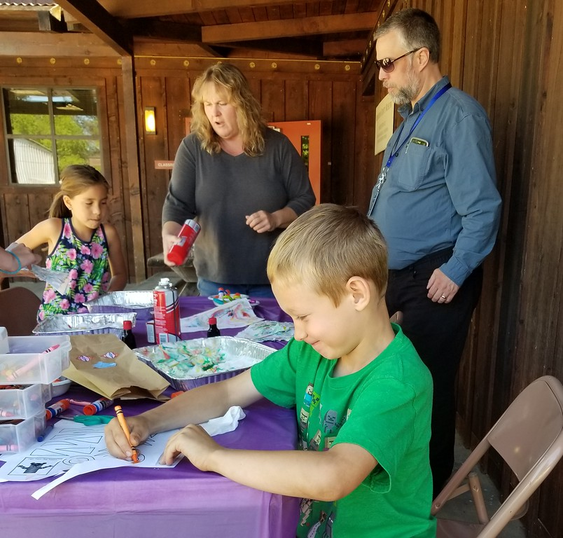 . Aura Whittaker for The Willits News Ella and Jerett learn how to make marbled paper with Mendocino County Library Director Karen Horner and Willits Library children�s librarian Benjamin McBean.