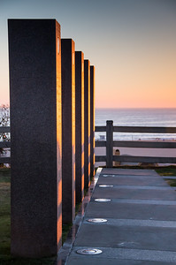 memorial pillars at sunset