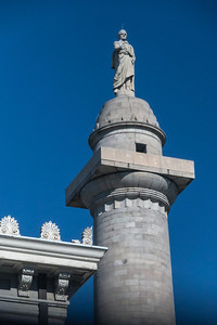 top of Washington Monument in Mount Vernon square, Baltimore, Maryland, with cornice on Walters Art Museum in the foreground (George is wearing a lightning rod, taken prior to 2014 renovation of the monument)