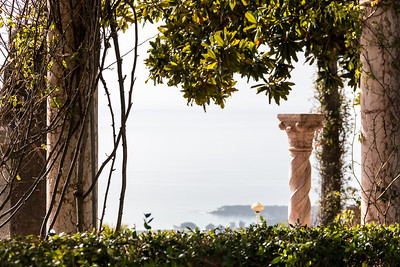 Julia Morgan's architectural garden ornaments make an art deco-style frame for the ocean view from the terrace at the front entrance to Hearst Castle.