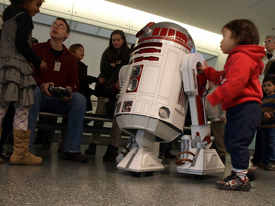 R2D1 was controlled by the human with the remote control at left.