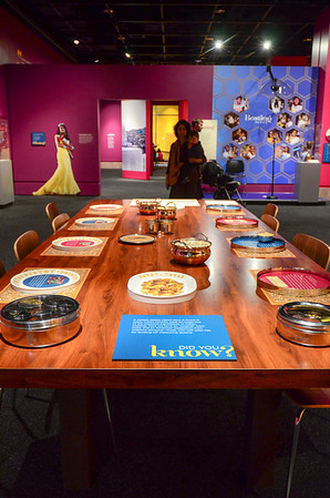 "Beyond Bollywood exhibition at the  National Museum of Natural History Washington DC March 2014.  There is a dining table full of information about food. ""A masala dabbe (spice box) is found in every Indian kitchen; each tin holds one of essential ingredients of Indian cooking."" Exhibition text"