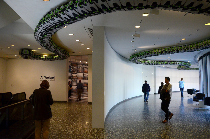 The snake on the ceiling is made from children's back packs. Smithsonian Institution Hirshhorn Museum and Sculpture Garden , Ai WeiWei, According to What?