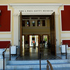Getty Villa : Oil magnate J. Paul Getty used some of his vast wealth to amass an incredible art and antiquities collection. In the early 70s, he had a Romanesque villa constructed next to his house to be a permanent museum for his collection. The Getty Villa, modeled after the partially excavated Villa dei Papiri in Italy, became the home of the J. Paul Getty Museum in 1974. After a nine-year, $275 million renovation and expansion the J. Paul Getty Museum at the Getty Villa has re-opened as home to the Museum's Antiquities Collection. In terms of pure grandeur, it puts most other art museums to shame. Only the Huntington Library & Gardens can rival the Getty Villa for the sheer beauty of its grounds and buildings. Perched atop a small hill overlooking Pacific Coast Highway and the ocean, the Getty Villa sits in all its elegance like some grand Roman villa of old.  (http://www.getty.edu/visit/)  In this location, I used the Nikon D40 and the Nikon AF-S 18-70 DX.  The lens came through as with the San Juan Capistrano shoot.