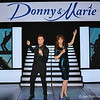 """June 2017<br /> <br /> I loved watching DONNIE AND MARIE OSMOND on television during my early teenage years.<br /> <br /> """"With a resounding gasp and overwhelming enthusiasm, Donny Osmond and Marie Osmond came face-to-face with their Madame Tussauds wax figures for the first time. The unveiling took place on stage inside The Donny & Marie Showroom at Flamingo Las Vegas during their first performance of the new year. For Marie, her figure looked so real she said, """"It's amazing how real they look... I've always wondered what it would be like to have sister."""" To that Donny replied, """"I have one sister and one is enough!"""" <br /> <br /> """"The figures are now permanently on display inside Madame Tussauds Las Vegas located at The Venetian. Donny Osmond and Marie Osmond's figures are the attraction's first new figures for 2016. The figures were created in late 2015. That was when Madame Tussauds' studio team first measured the brother-sister duo. This step of the process involved collecting hand impressions and nearly 300 precise body and facial measurements per person, as well as comparing hair samples and eye color. For measuring, calipers were utilized to ensure accuracy. The figures were then sculpted and perfected in clay by hand. Once this step was completed, the clay was covered by a plaster cast, subsequently the clay was removed from the cast, the wax was poured in and allowed to cool, leaving the shape of the figures.""""<br /> <br /> """"The final weeks of 2015 were spent meticulously inserting each hair by hand then fitted with acrylic eyes and teeth. The final step included countless layers of tinted paint being applied to build up skin tones and replicate their faces. The figures are dressed in costumes from their show. Marie donated her deep aqua sequined knee-length dress, along with earrings and black and blue platform shoes. Donny gave his figure his black suit and shoes. Both of their wedding bands and rings were replicated for the figures as well.""""<br /> <br /> """