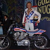 """June 2017<br /> <br /> Vroom, Vroom, and Zoom, Zoom with EVEL KNIEVEL.<br /> <br /> Motorcycle performer and entertainer. Robert Craig """"Evel"""" Knievel, Jr. was born October 17, 1938, in Butte, Montana. Raised by his grandparents in Butte, a copper-mining town, he began doing motorcycle stunts as a teenager. He embarked on an incredibly varied career (1956??65) that included professional hockey, a stint in the U.S. Army, work in the copper mines, and eventually crime - safecracking and holdups. He ??went straight?? in 1965 and formed a troupe called Evel Knievel's Motorcycle Devils. He rode through fire walls and jumped over live rattlesnakes.<br /> <br /> Evel Knievel steadily increased the length and danger of the jumps until, on New Year's Eve 1967 he was nearly killed when he jumped the fountains in front of Caesar's Palace in Las Vegas. The crash landing put him in the hospital in a coma for 29 days. Knievel??s many dangerous and thrilling stunts, including jumps over Greyhound buses, live sharks and Idaho's Snake River Canyon, made him an international icon in the 1970s. Immortalized in the Washington's Smithsonian Institution as """"America's Legendary Daredevil,"""" Knievel suffered nearly 40 broken bones before he retired in 1980.<br /> <br /> Knievel married hometown girlfriend, Linda Joan Bork, in 1959. They separated in the early 1990s. They had four children, Kelly, Robbie, Tracey and Alicia. After Evel retired, he managed Robbie's stunt career. Knievel married his longtime partner, Krystal Kennedy-Knievel in 1999. They divorced a few years later but remained together. Knievel had 10 grandchildren and a great-grandchild.<br /> <br /> Knievel had undergone a liver transplant in 1999 after nearly dying of hepatitis C, likely contracted through a blood transfusion after one of his bone-shattering spills. Motorcycle daredevil Evel Knievel who defied death for decades died on November 30, 2007 in Clearwater, Florida. He had been in failing health for years, sufferin"""